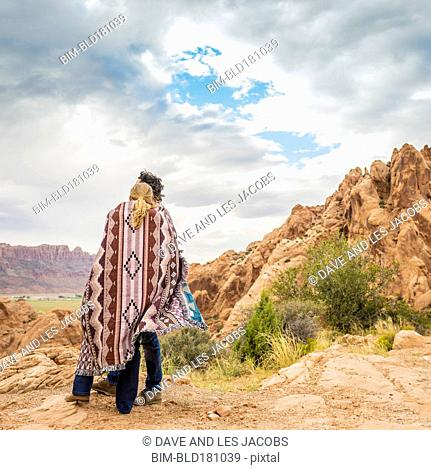 Hispanic couple admiring view from rock formation
