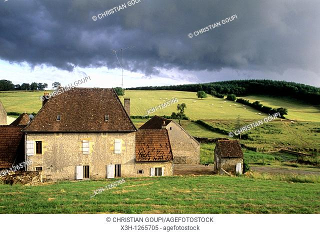 farmhouse under stormy sky, around Nevers, Nievre department, region of Burgundy, center of France, Europe