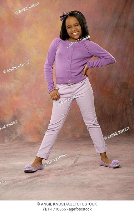 Cute ten year old African American wearing a casual purple outfit