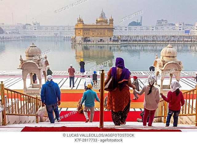 pilgrims and sacred pool Amrit Sarovar, Golden temple, Amritsar, Punjab, India