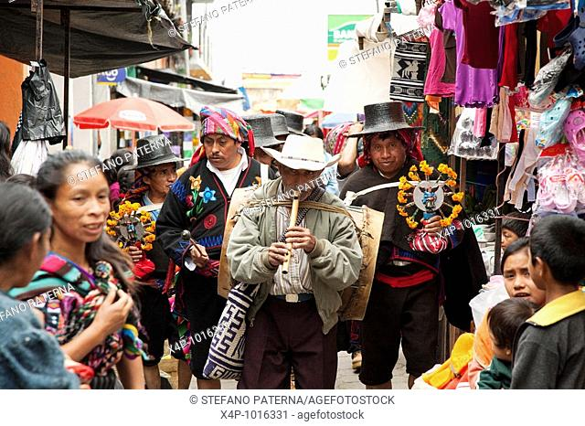 Religous procession at the market of Chichicastenango Guatemala