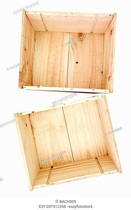 A studio photo of an empty pine box