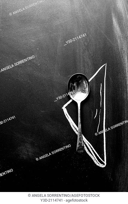 Silver vintage spoon on black background