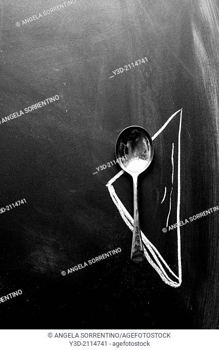 Silver vintage spoon on black background