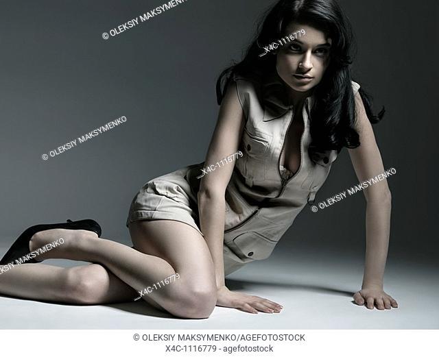 Young beautiful woman in short deerskin dress fashion photo