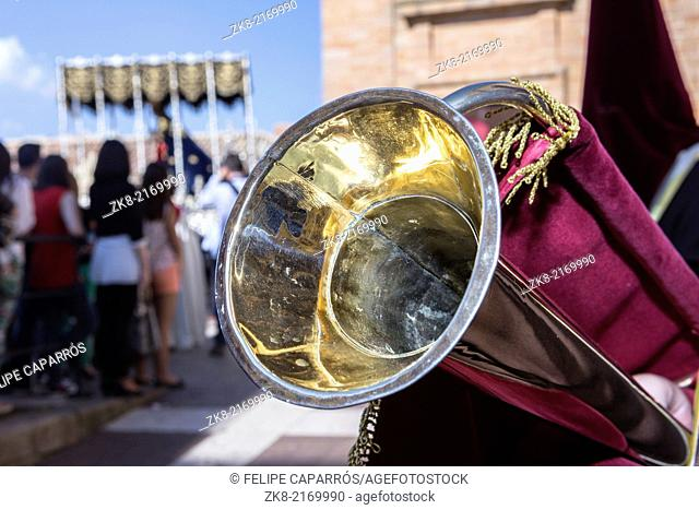 Linares, Jaen province, SPAIN - March 17, 2014: Nuestra Señora de los Dolores going out of the church of Santa Maria, detail of typical elongated trumpet of...
