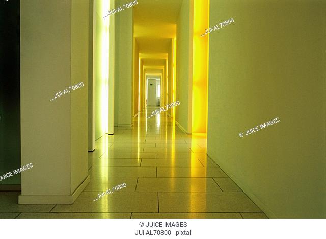 Detail view of a hallway with light shining in through doorways