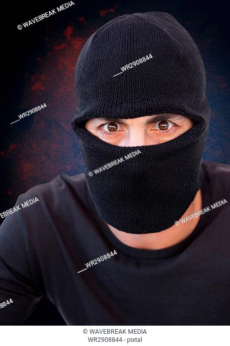 Criminal in balaclava with blue background