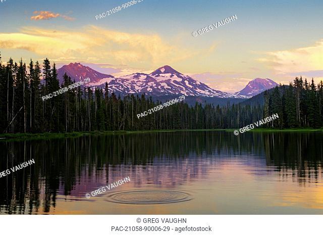 Oregon, Cascade Mountains, Scott Lake and Three Sisters mountain peaks, Sunset light