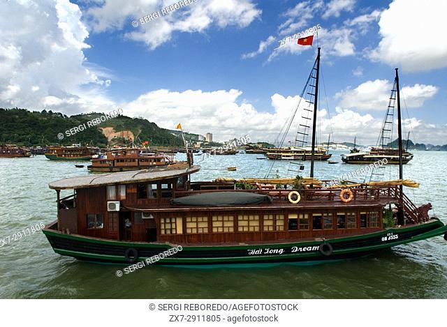 Chinese Junk, Halong Bay Tourist Boat Tour, Vietnam. Junk, boat sailing amongst karst limestone mountains at Cat Ba National Park, Ha long,Halong Bay, Ha long