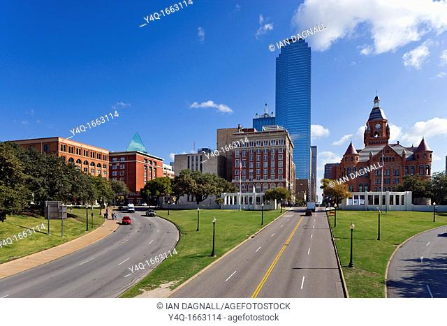 Site of the Kennedy assassination looking towards Deaey Plaza with old Texas Schoolbook Depository to the left and Old Red Courthouse to the right, Dallas