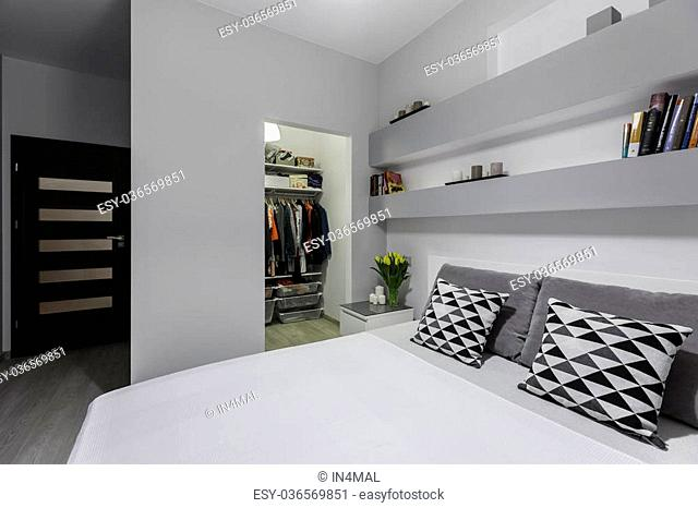 Comfortable double bed in big and modern designed bedroom