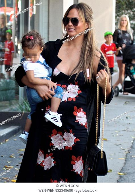 Chrissy Teigen takes her daughter Luna to Au Fudge Featuring: Chrissy Teigen, Luna Where: West Hollywood, California, United States When: 22 Sep 2017 Credit:...