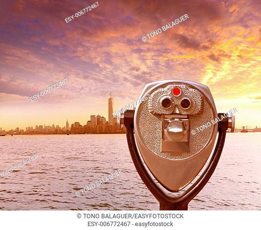 Manhattan skyline New York telescope from Liberty Island US USA