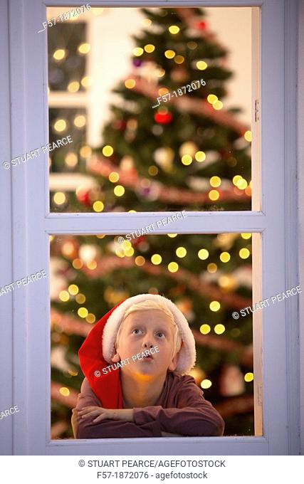 Young boy waiting for santa claus