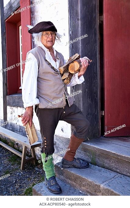 Elderly man in period costume in a re-enactment of everyday life in18th Century Fortress of Louisbourg. He is portaying a handyman who performs various chores