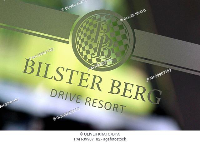 Logo of the car race track 'Bilster Berg Drive Resort' stands on a glass door in the reception area in Bad Driburg, Germany, 30 April 2013