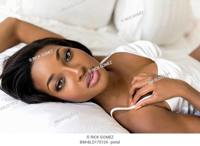 African American woman laying on bed