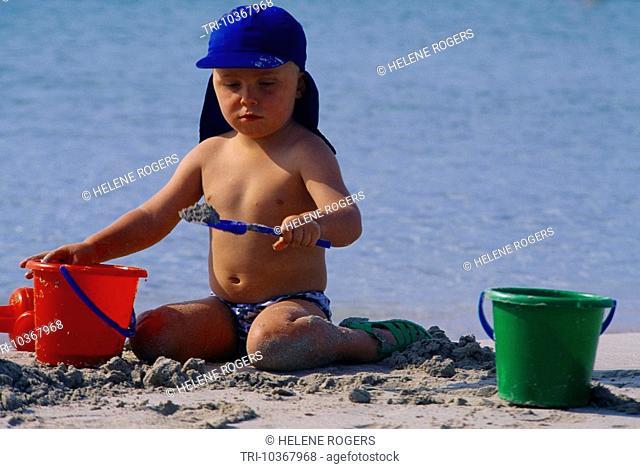 Menorca Balearic Islands Spain Son Bou Child With Bucket & Spade On Beach