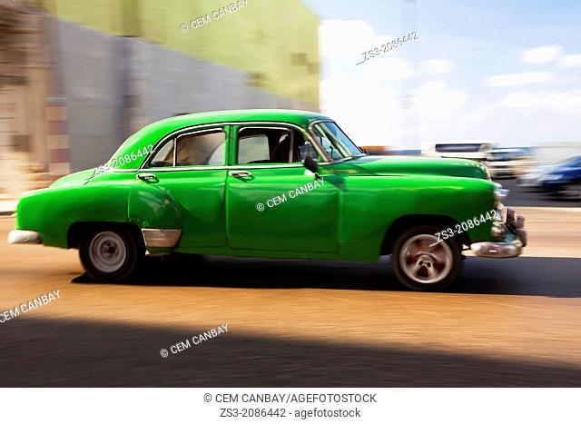Dynamic scene of an old american car, Malecon, Havana, Cuba, West Indies, Central America