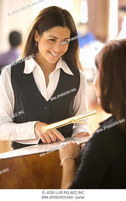 Hostess helping customer at restaurant