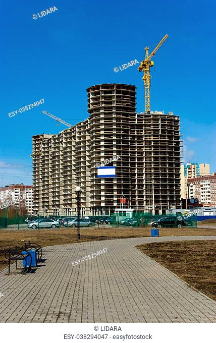 Under construction residential house in modern suburban distict, Russia