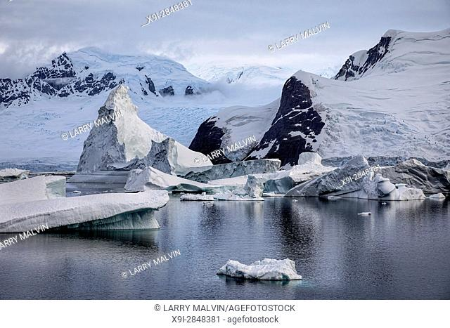Icebergs, glaciers and mountains along the waters of the Antarctic Peninsula