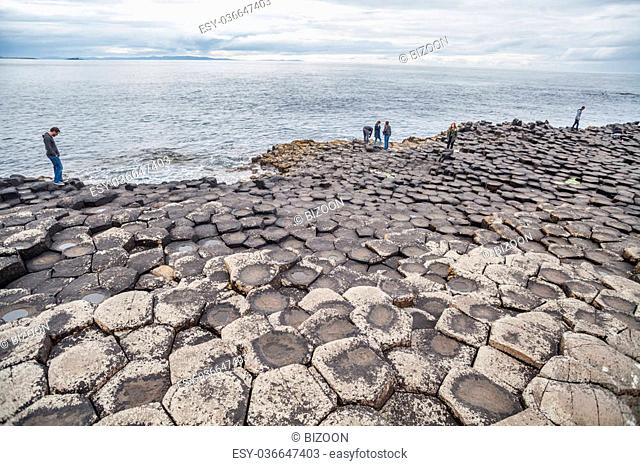 Co.Antrim, Northern Ireland - July 30, 2015: A group of tourists exploring the Giant's Causeway in the Summer of 2015