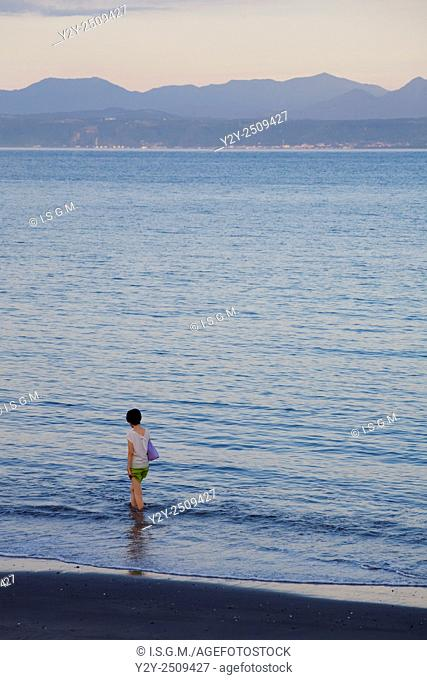 Woman in the beach, at Ibusuki town, Kagashima prefecture, Japan