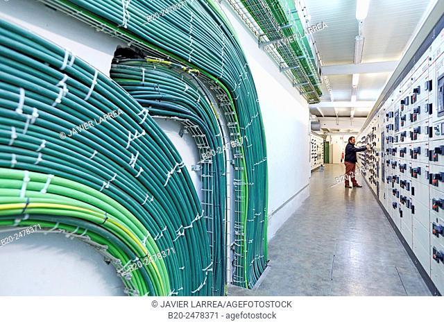 Technician by electrical panels at maintenance area, Hospital Donostia, San Sebastian, Basque Country, Spain