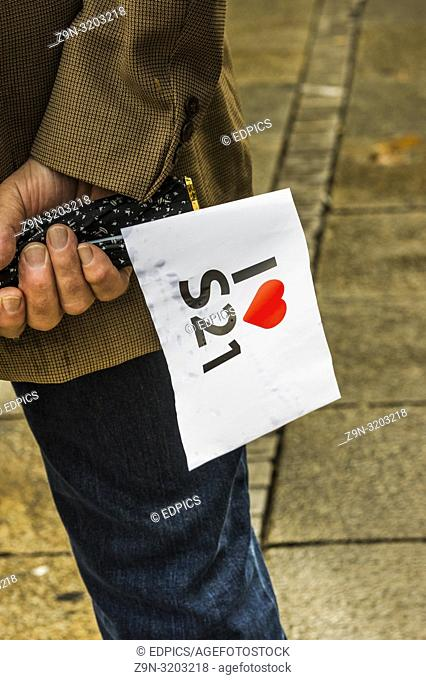 man holding a -i love stuttgart 21- flag, stuttgart, baden-wuerttemberg, germany
