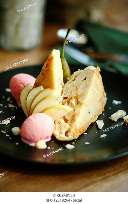 Two pieces of pear cake with ice cream