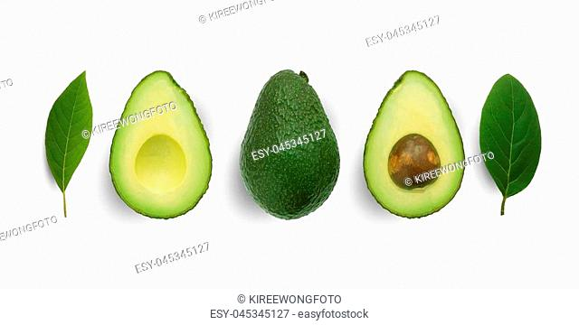 Seamless pattern with avocado and leaves on white background. Whole and half avocado with leaves.Food concept