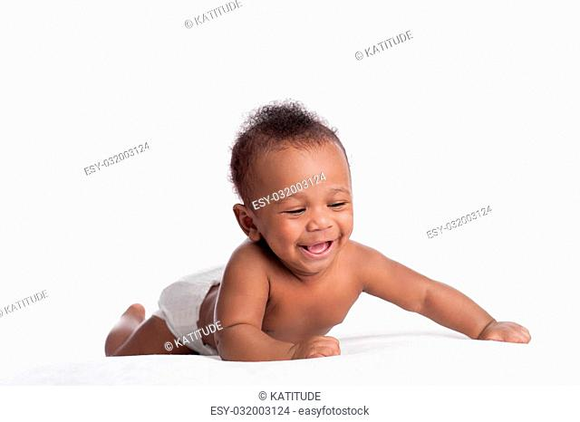 A laughing, six month old baby boy wearing diapers. Shot in the studio on a white background