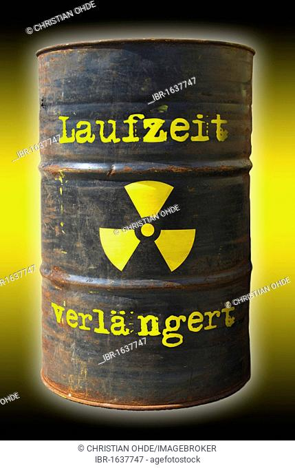 Rusty barrel with a radiation warning symbol and lettering Laufzeit verlaengert, German for extended runtime