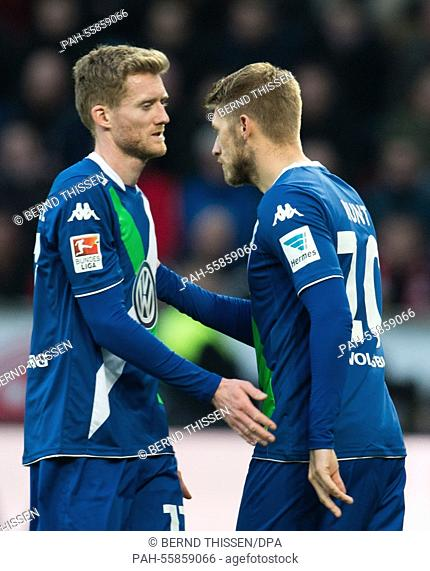 Wolfsburg's Andre Schuerrle is substituted by Aaron Hunt during the German Bundesliga soccer match between Bayer Leverkusen and VfL Wolfsburg in the BayArena in...