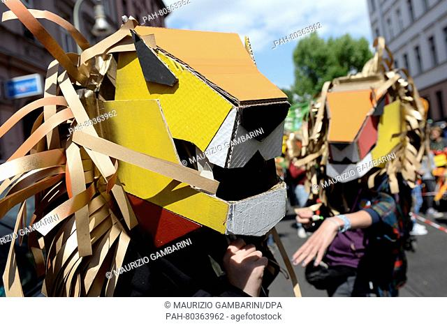 Children dressed as lions at the childrens carnival with the motto '20 Years with a Roar' during the 'Karneval der Kulturen' in Berlin, Germany, 14 May 2016