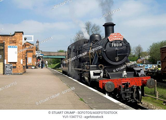 Steam Locomotive Train on the Great Central Railway arriving at Quorn & Woodhouse Railway Station, Leicestershire, England, UK
