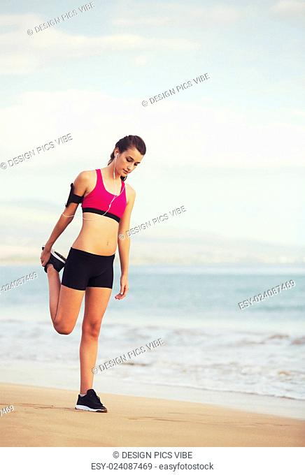 Healthy Active Lifestyle. Young sports fitness woman on the beach at sunset ready for workout