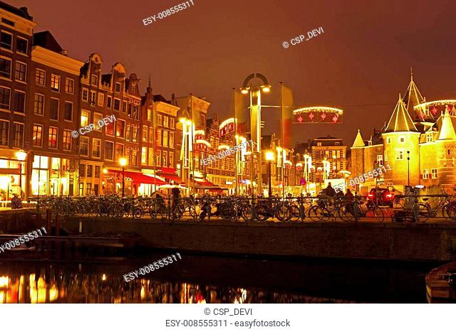Amsterdam by night in the Netherlands with the Waag building