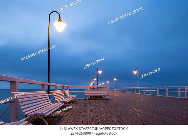 Winter dawn on the pier in Gdynia Orlowo, pomorskie, Poland