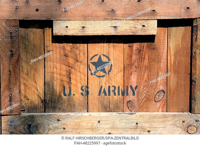 A wooden US Army box is part of a rebuilt US Camp including gold bars, stolen art, and military jeep in Potsdam, Germany, 29 April 2014