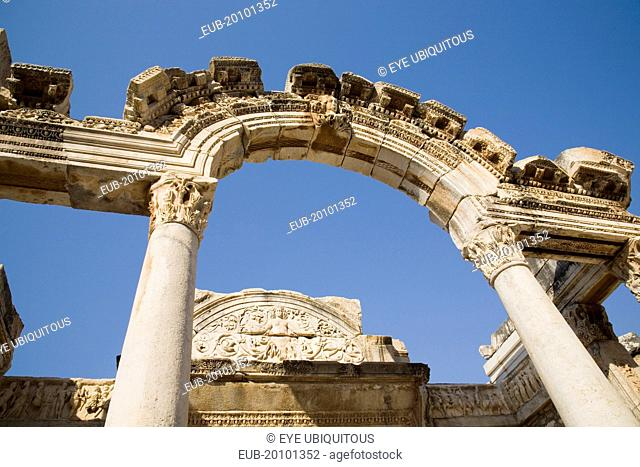 Ephesus. Carved archway supporting columns and wall frieze in antique city of Ephesus on the Aegean sea coast