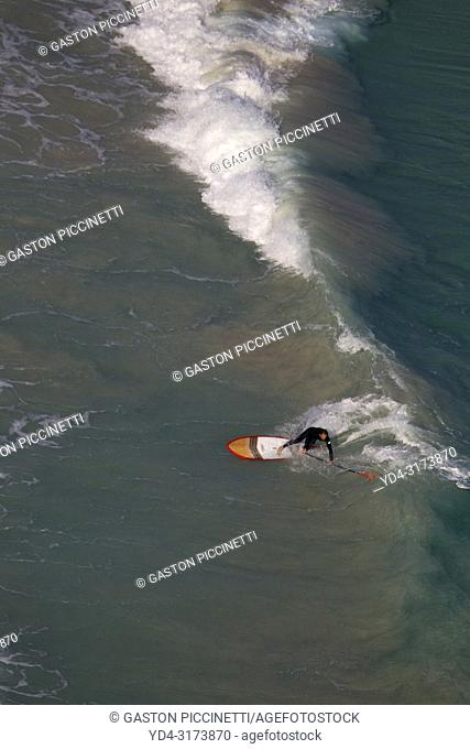 A person making paddle surfing, Majorca, Balearic Island, Spain. Aerial view picture