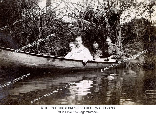 Four men in a rowing boat, probably on the river in Oxford during the First World War. The young man in uniform on the right is Harold Auerbach