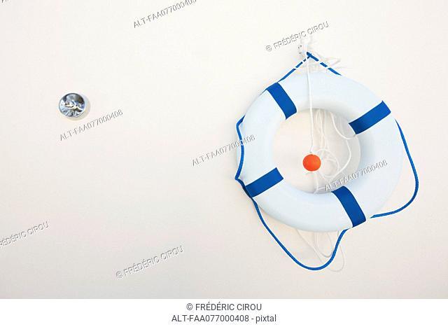 Life preserver hanging on wall