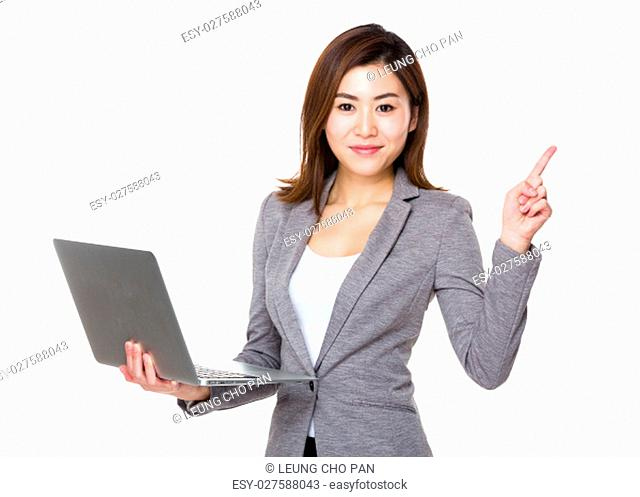 Businesswoman hold with notebook computer and finger point up