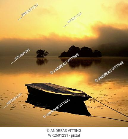 Fishing boat and little islands at sunrise and morning mist, Edersee, Edersee Dam, Hesse, Germany