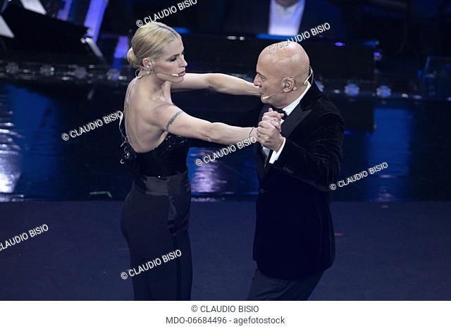 Italian presenter and comic Claudio Bisio and Italian presenter Michelle Hunziker during the second evening of the 69th Sanremo Music Festival