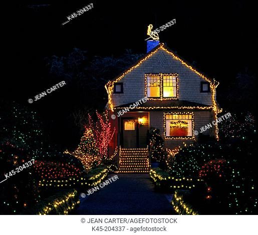 Holiday lights decorate Garden Cottage at Shore Acres State Park, Southern Oregon coast, USA